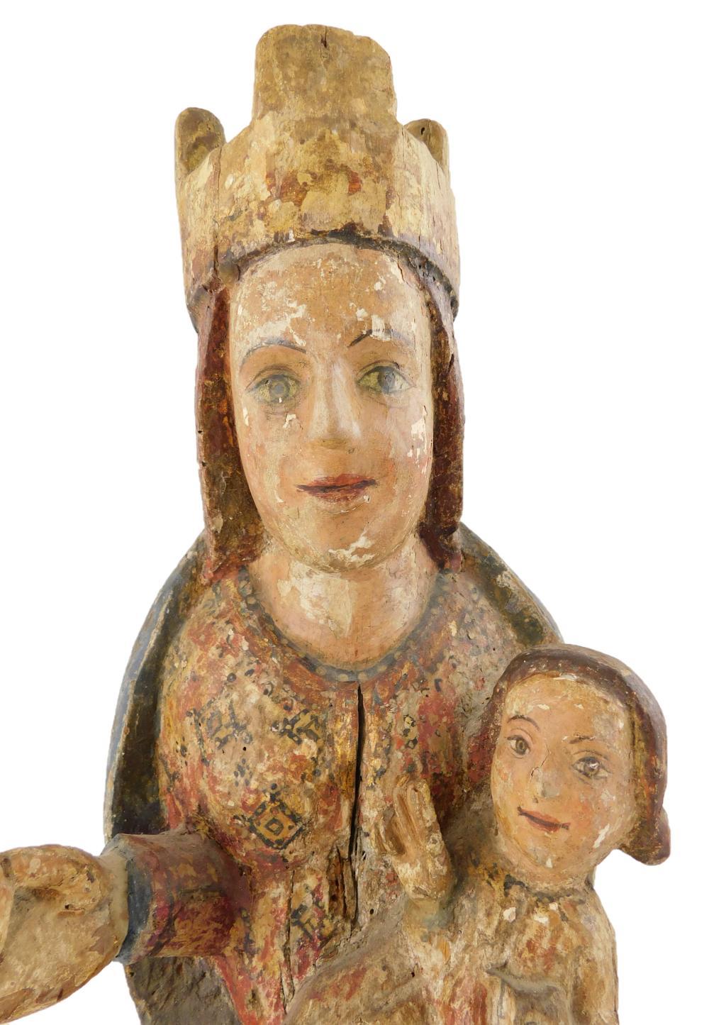 Virgin and Child wood sculpture, possibly Spanish, medieval, with carved wooden wall bracket, traces of polychrome and gilding, devo...