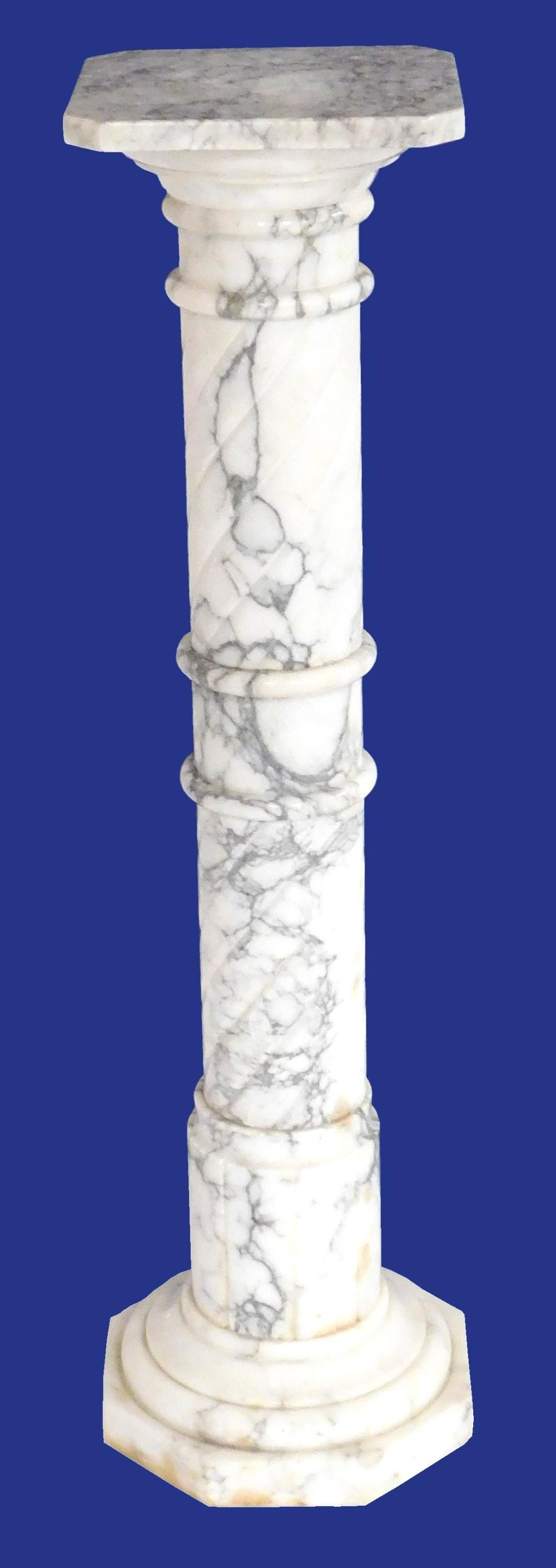White and grey variegated marble pedestal in two pieces, square top with cut corners, column standard with rings and incised spiral...