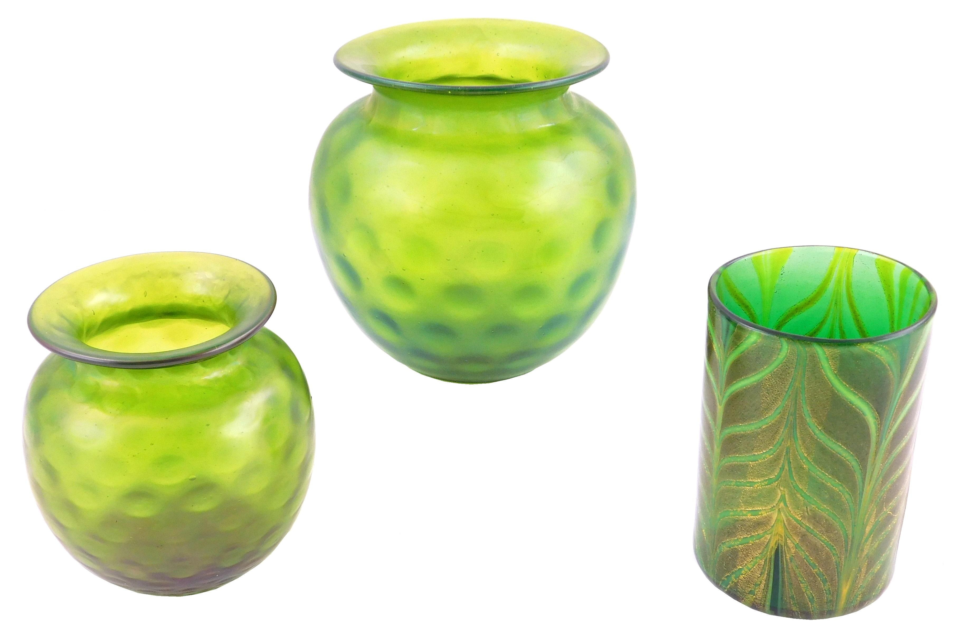 GLASS: Art glass, Central Europe, early 20th C., including a cylindrical vase, green with pulled feather decoration and two similar...