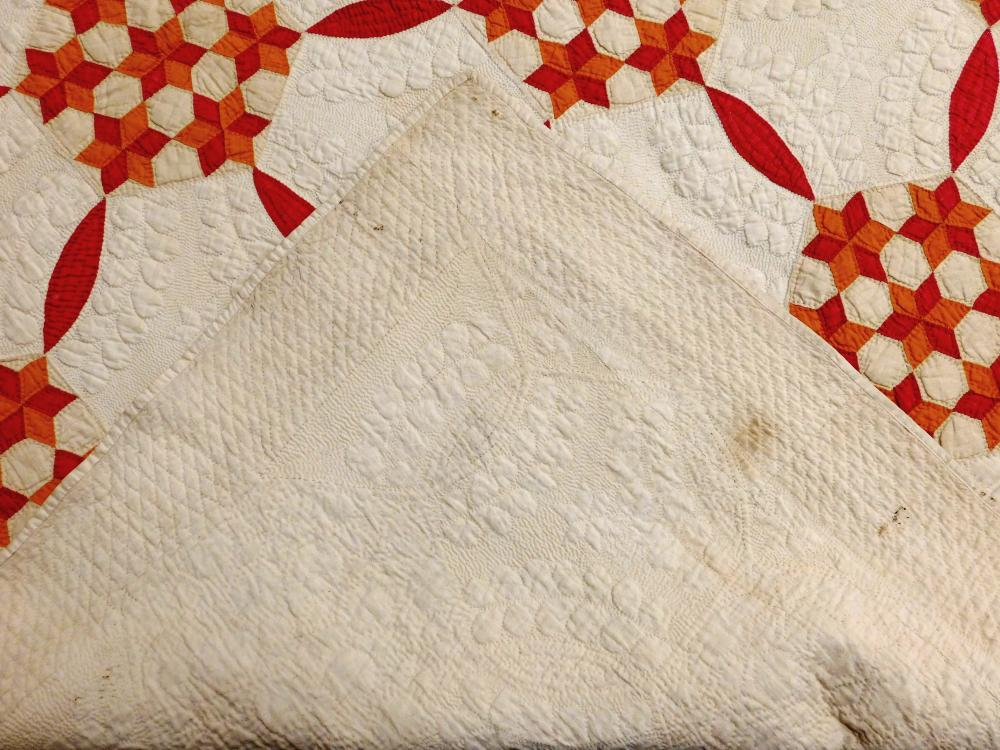Early American hand quilted Broderie Perse quilt, orange and red appliques on off-white field, interesting clustered star pattern en...