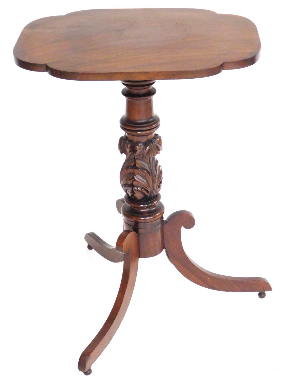 Late Federal tilt top stand, mahogany, oblong top with rounded incut corners over a nicely carved standard with acanthus leaf decora...