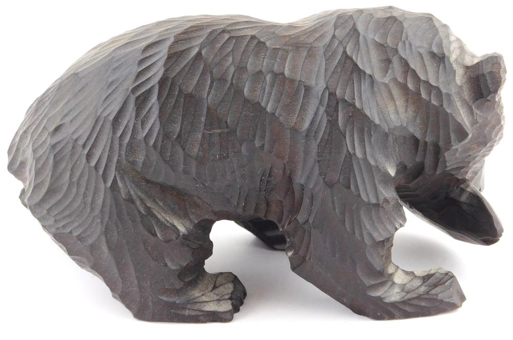 Two wood carvings, the first an eagle on rocky outcrop, wings spread open, eyes are plastic or glass, the tongue is metal, signed in...