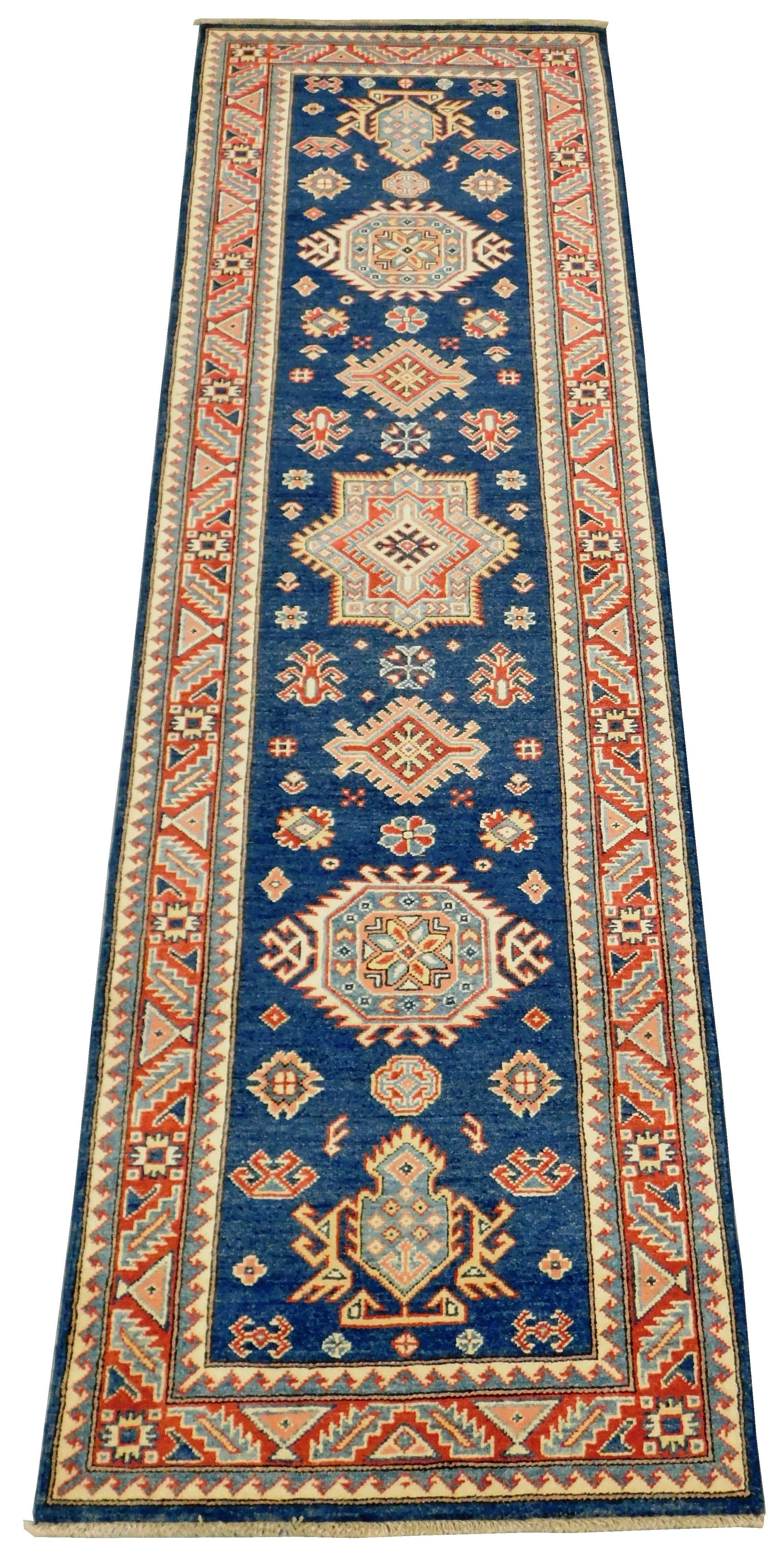 "RUG: Uzbek Kazak runner, 2' 10"" x 9' 9"", ocean blue field, ensconced in red serrated geometric border, serrated geometric medallions."