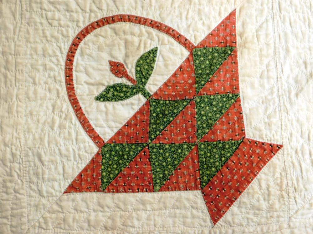 Needlework quilt with basket applique design, total of thirty-six baskets, red and green baskets set against white field, small flow...