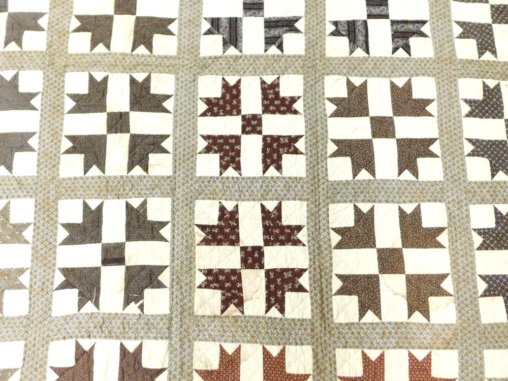 Two needlework quilts, including: 19th C. needlework Goose Tracks quilt, varied brown and off-white print squares, brown and red pri...