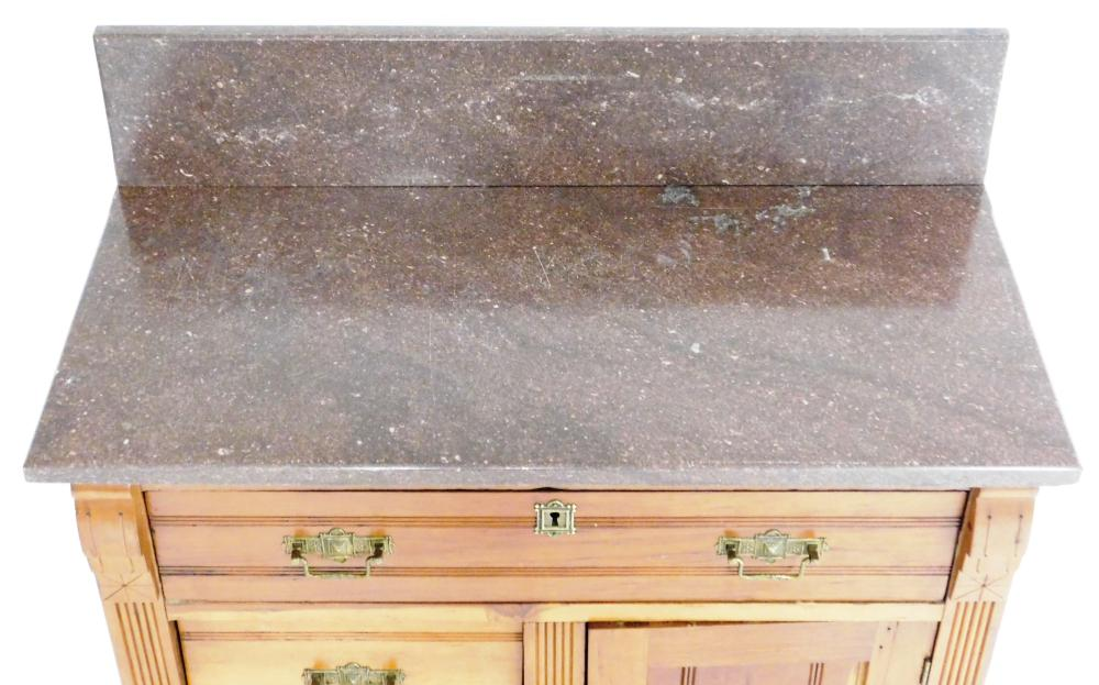 Victorian marble-top commode with backsplash, incised linear decoration to case, elaborate stamped brass pulls and escutcheon, long...