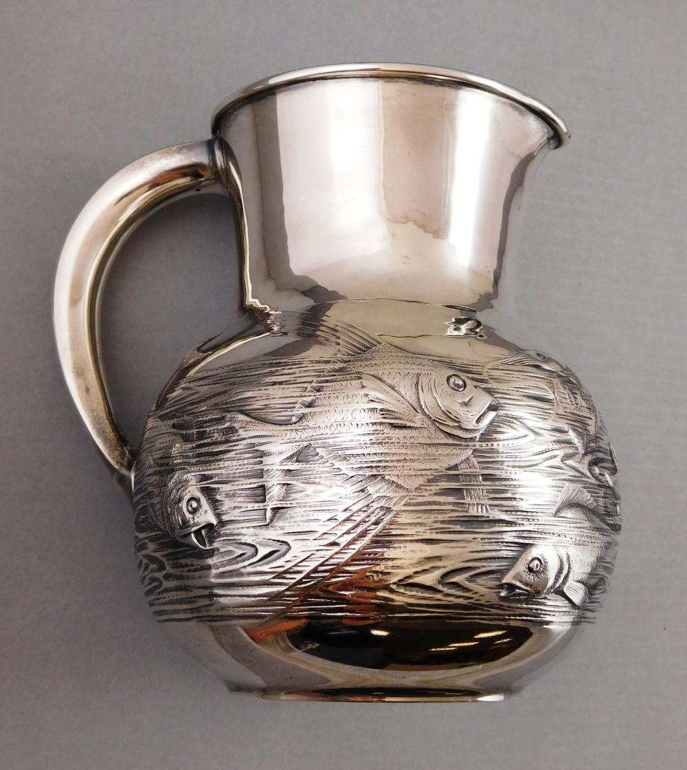 STERLING: Gorham sterling silver pitcher #1150-P with aquatic relief decoration, featuring several fish, an eel, shrimp, etc., in ri...