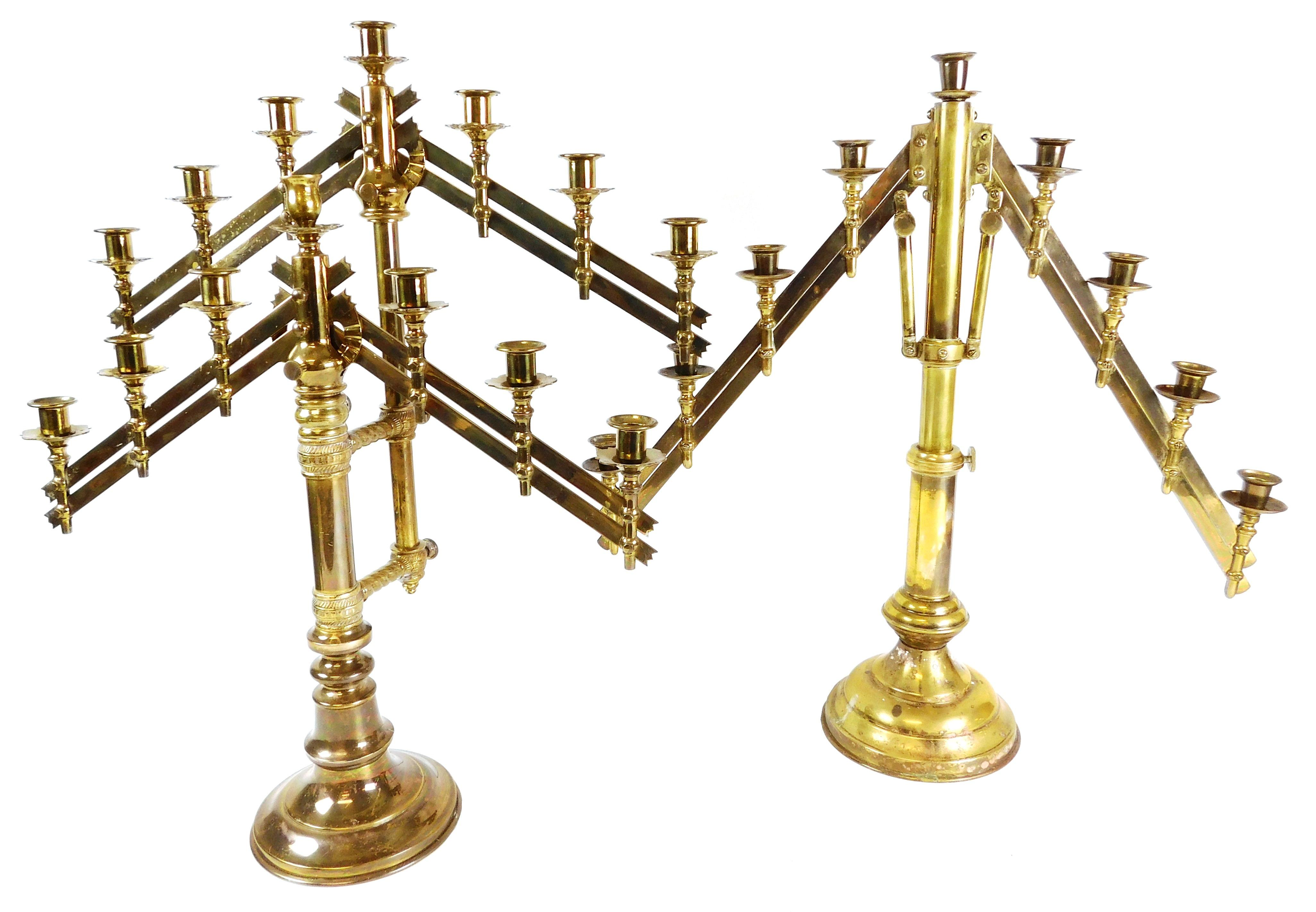 Two adjustable brass candelabras; arm on each side is movable up and down, lights along arm adjust to height as it changes, one with...