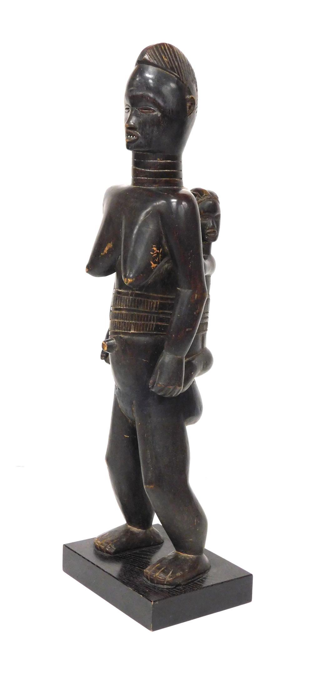 African Lü Me Maternite figure, Dan Tribe, Ivory Coast, Liberia, Henri Kamer provenance, c. 1940, dark patina carved wood, metal tee...