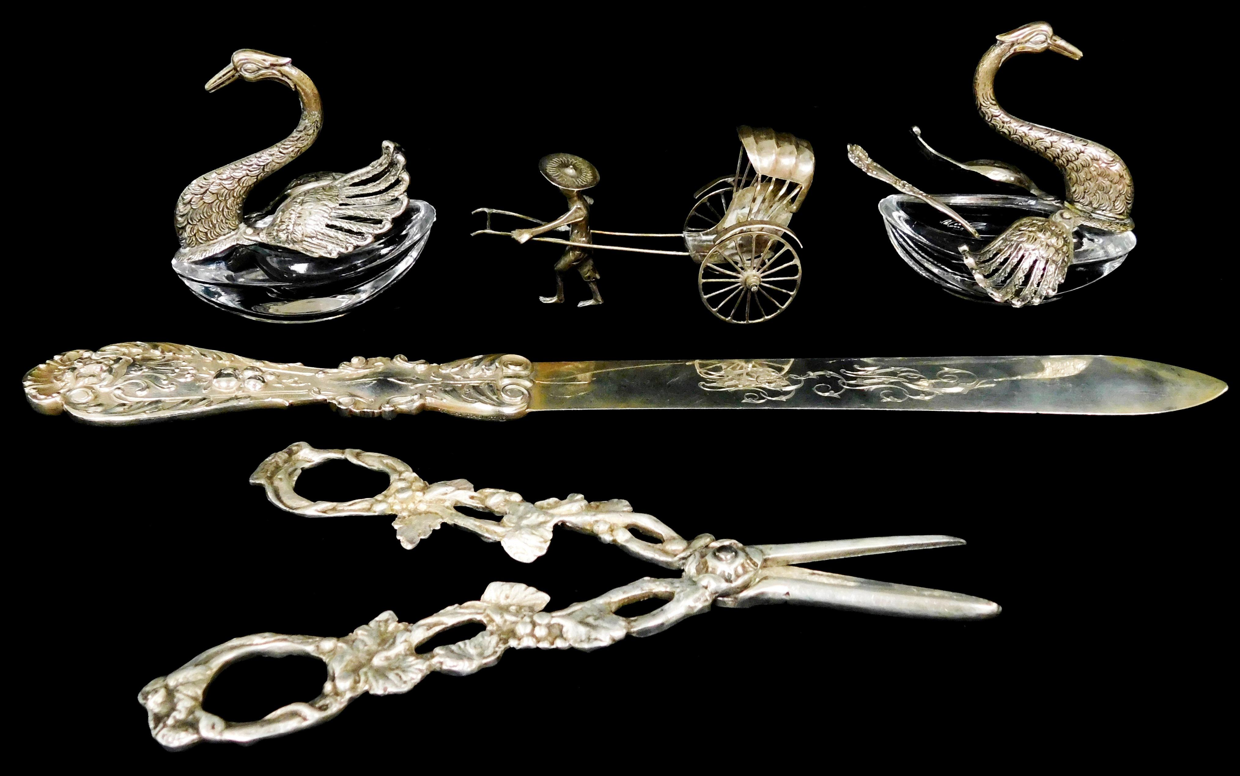 """SILVER: Five pieces including: two glass and '800' swan salts, stamped on wing tip, 3"""" h., unweighable; salt spoon, 2 1/2"""" l.; ricks."""