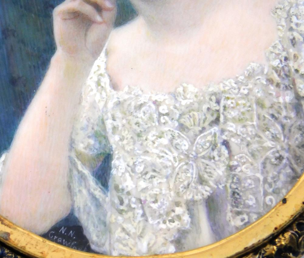 """MINIATURE: Woman, oval support, dark hair and eyes, upswept hair, embroidered white lace dress, signed """"N. N. Crawford"""" lower left,..."""