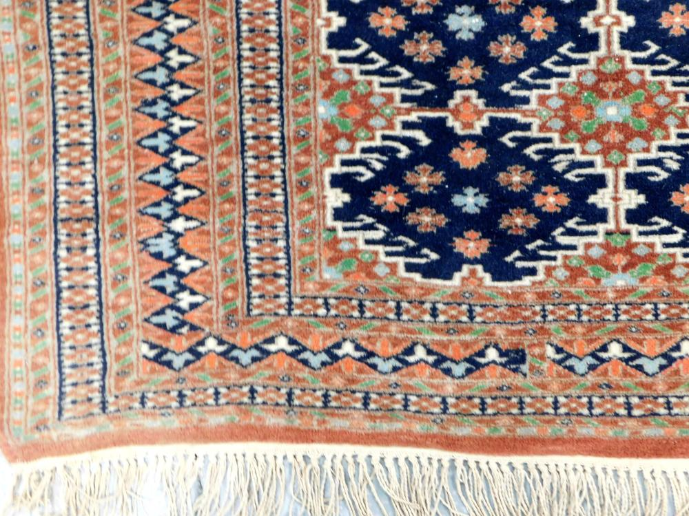 """RUG: Modern handwoven Persian style, 6' x 4' 2"""", 100% wool on cotton, two rows of eight dark navy latch hook geometric medallions, a."""