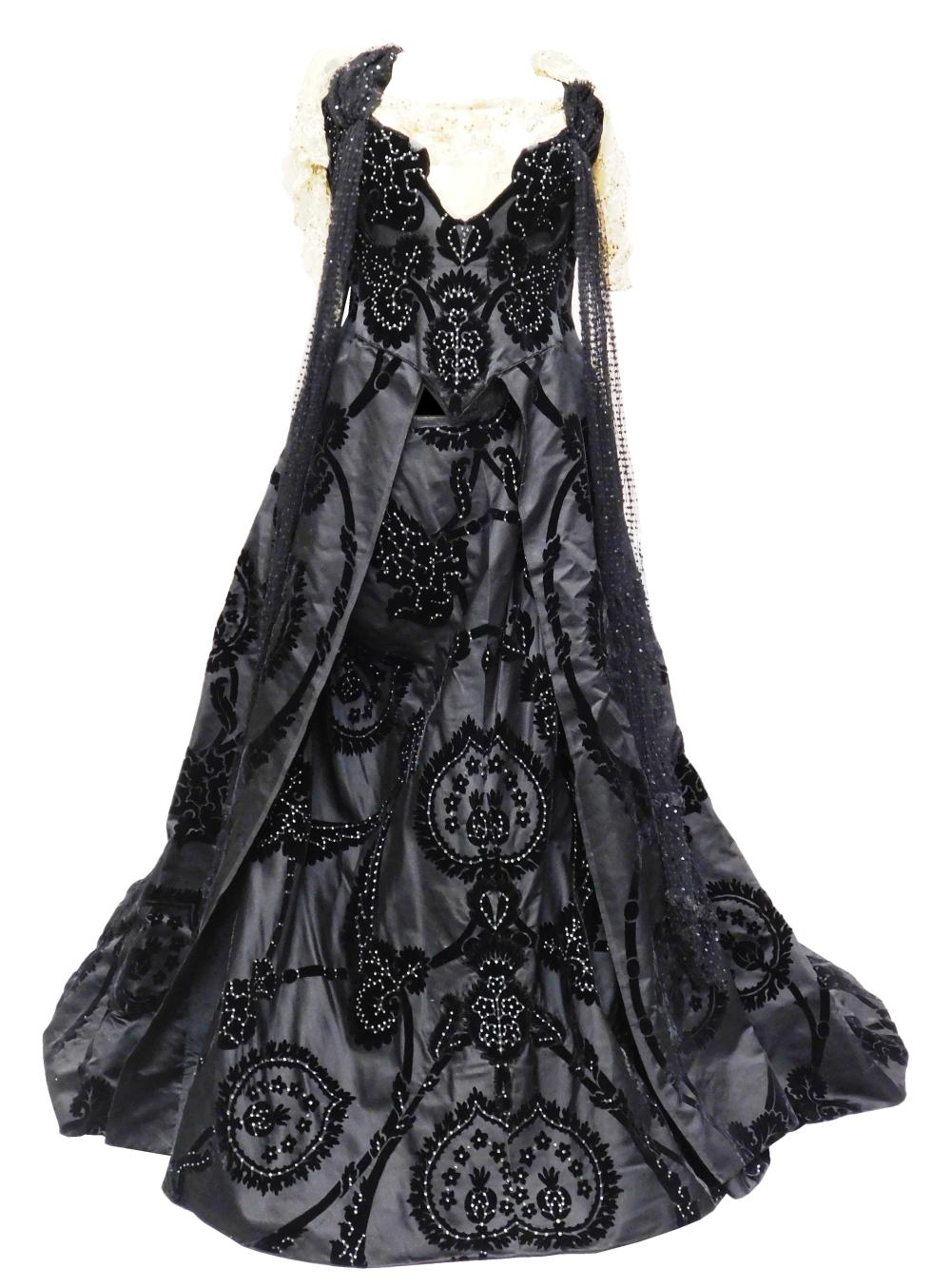 House of Worth black velvet brocade evening dress, c. 1890's, museum provenance, details include: black brocade velvet bodice and sk..