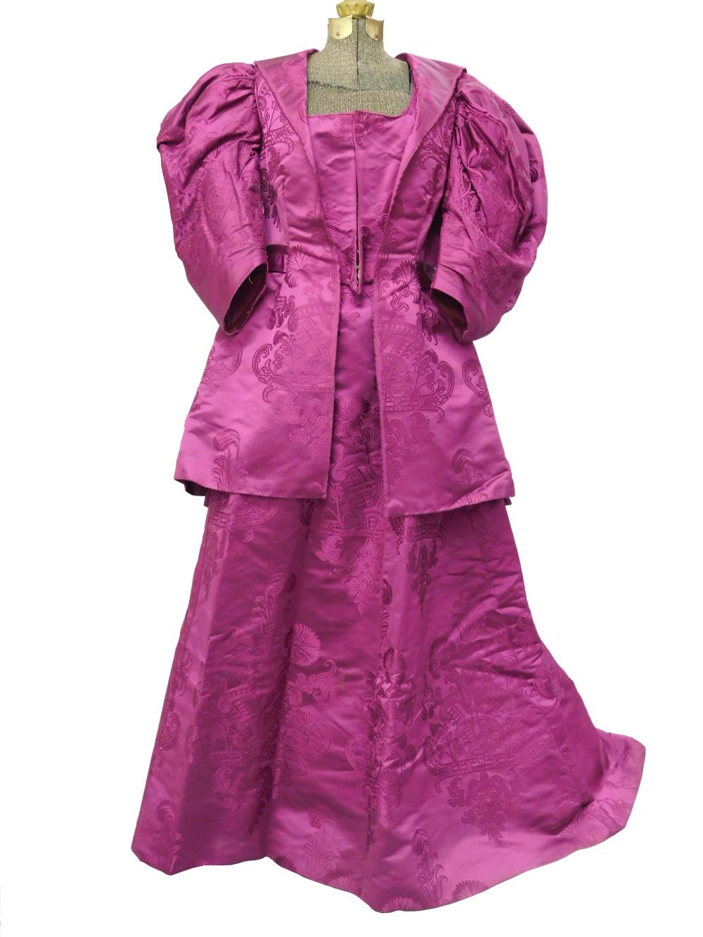 House of Worth fuchsia brocaded silk reception dress, c. 1890's, two pieces, jacket and skirt, museum provenance, details include: j..