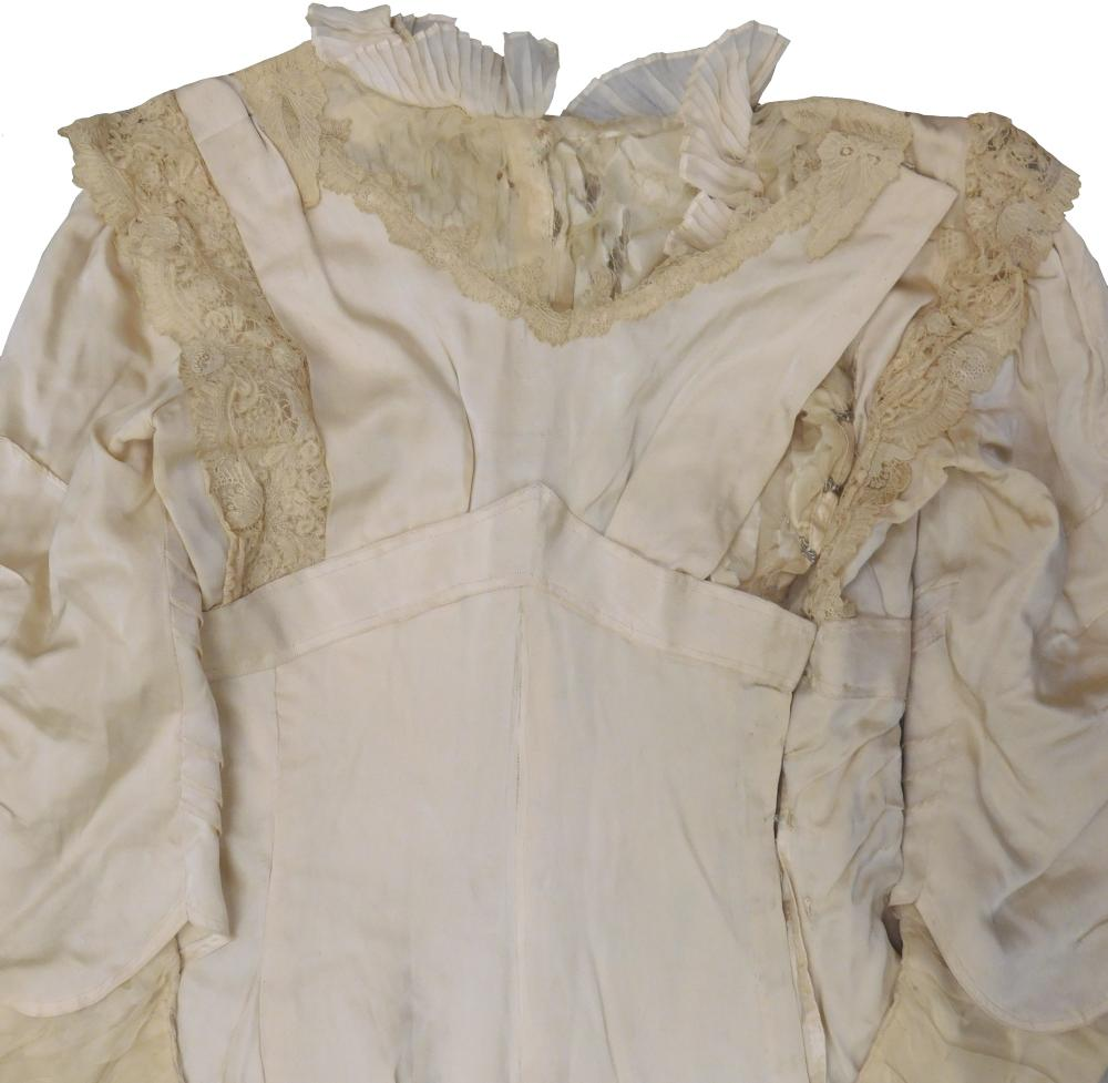 Two Victorian silk gowns and a parasol, details include: one eggplant colored gown with high lace neck and empire waist, buttons wit...
