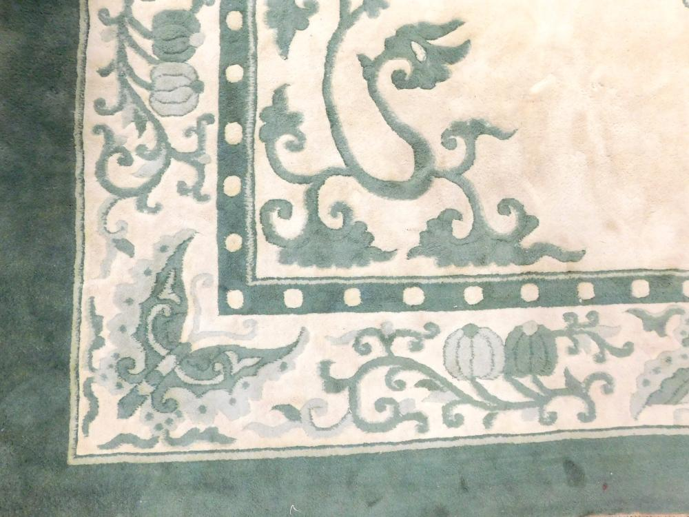 """RUG: Modern Indo-Chinese, 12' x 17' 11"""", 100% wool on cotton, two-tone sage green and cream with butterflies and flower buds in bord."""