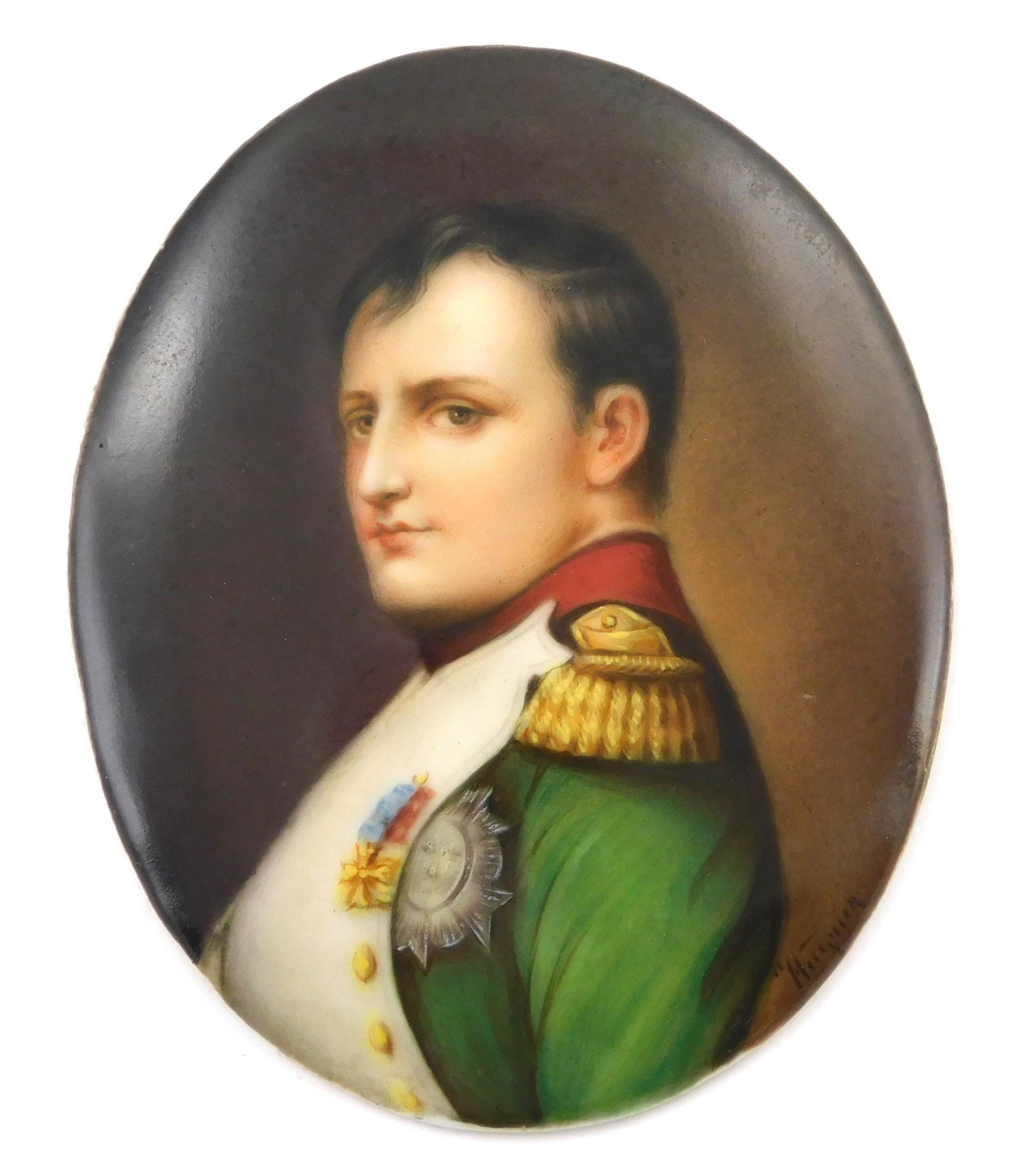 MINIATURE: Napoleon profile portrait, oval porcelain support, wearing green jacket with red collar and military medals, with paper l...