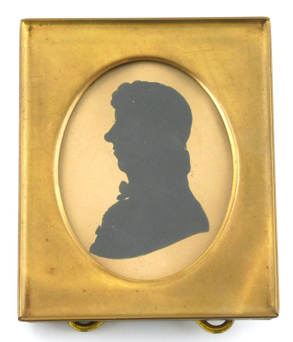 """Five framed silhouettes, including: one hollow cut with added drawn accents of hair texture and ruffled collar, signed """"Doyle""""; two..."""