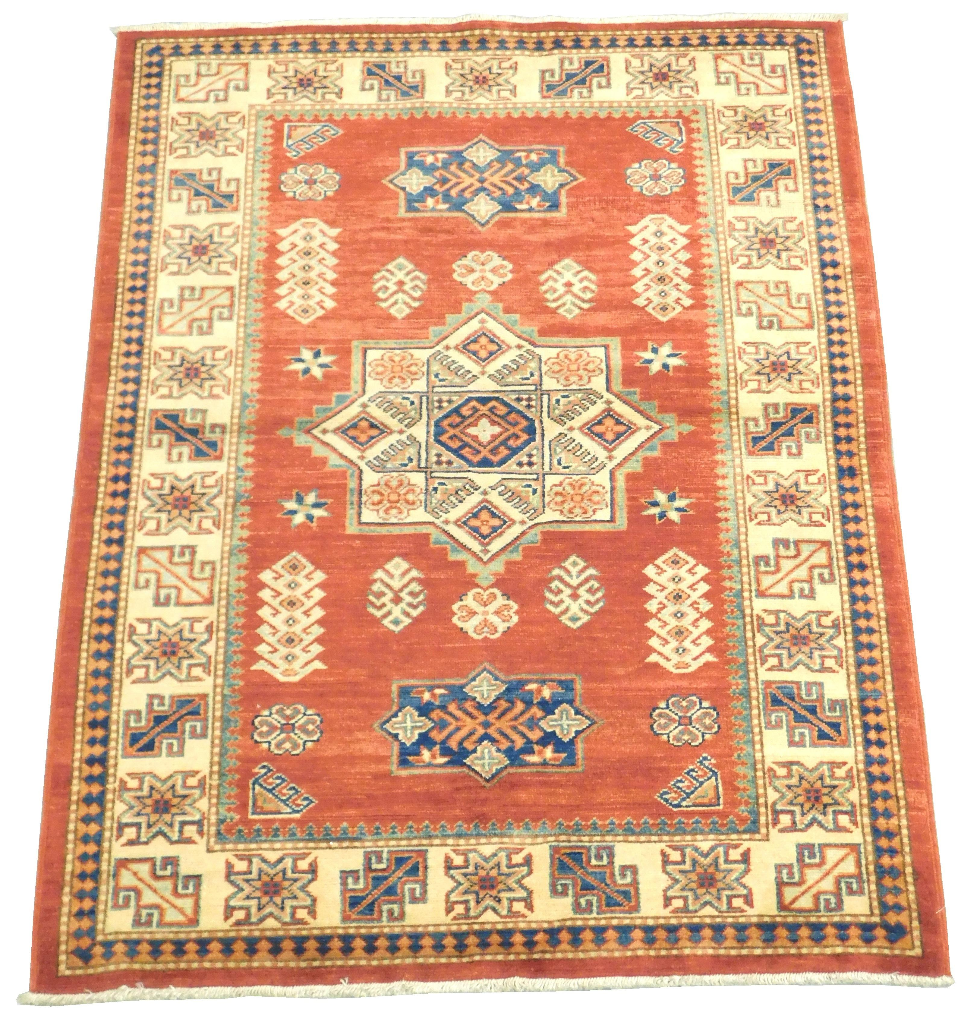 """RUG: Uzbek Kazak, 4' 3"""" x 5' 6"""", soft red field, ensconced in cream primary border with cream and blue medallion, accents of blue, g."""