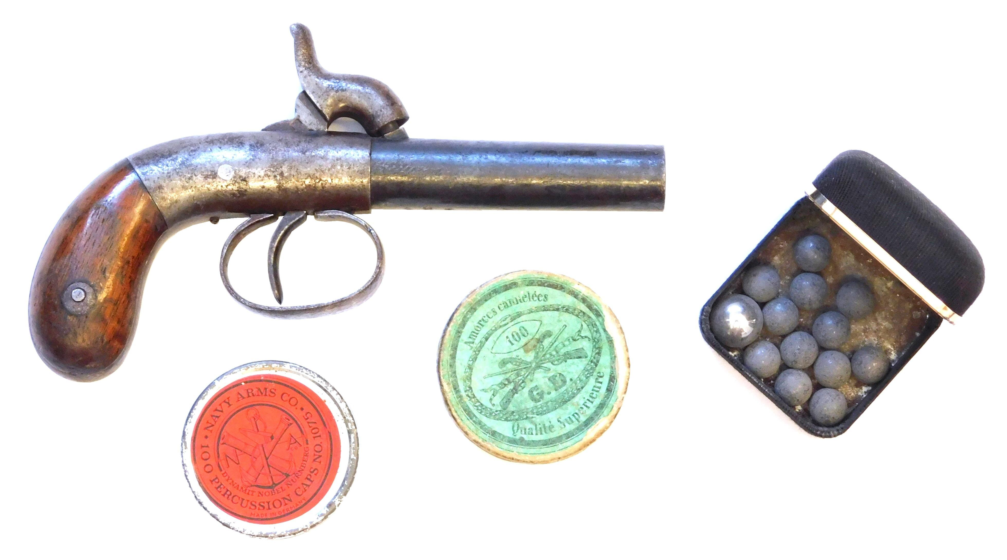 Single shot boot percussion pistol, not working, with two containers of caps and one box of balls, most likely made by Allen & Thurb...