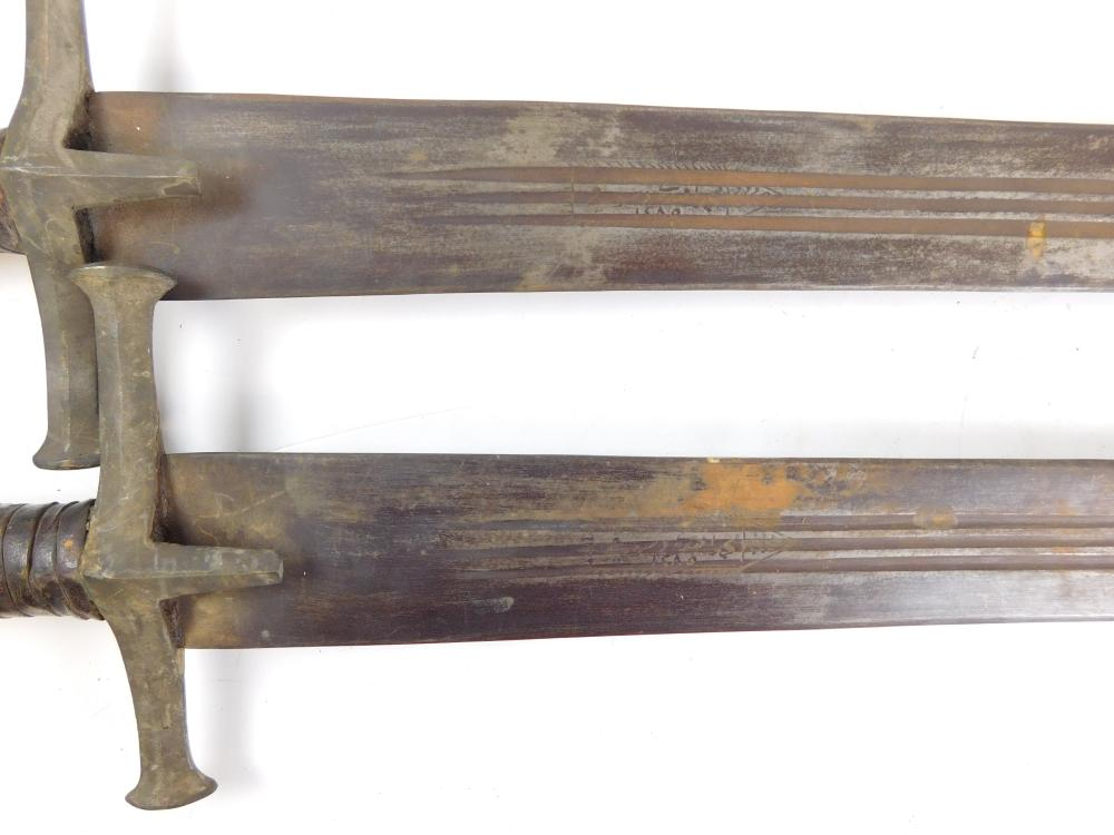 WEAPON: Pair of Coptic/Middle Eastern/Egyptian 19th C. or older broad swords, maker marked blades (a matched pair), wear consistent...
