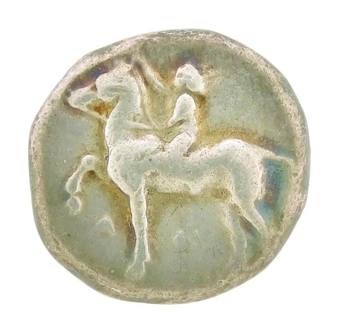 COIN: Ancient Greece Calabria, Taras. Circa 302-280 BC AR Nomos. Horseman riding stepping horse, Taras riding dolphin. nVF with plan...