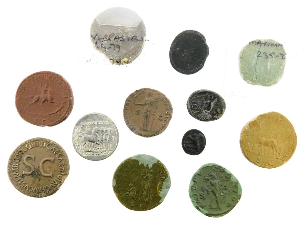 COINS: Lot of 8 plaster casts of Ancient Roman coins many with edge chipping, one broken, also, 3 modern base metal replicas of Anci...
