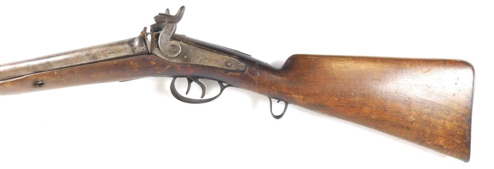 WEAPON: 19th C. Percussion double barrel 16 gauge shotgun, wear consistent with age and use, sold as found, not working. [PROVENANCE...