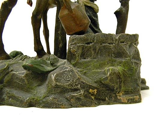 Franz Bergman cold-painted bronze mulifigural group sculpture depicting Arabian trader mounted on camel accepting water jug from vei...