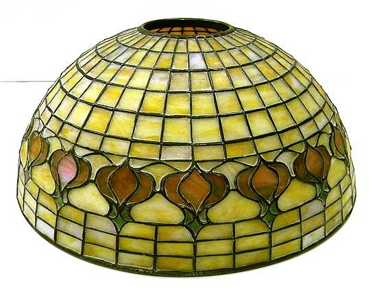 Tiffany Studios table lamp, pomegranate leaded glass shade, #1457, signed on rim, shade in excellent condition, bronze base with bro...