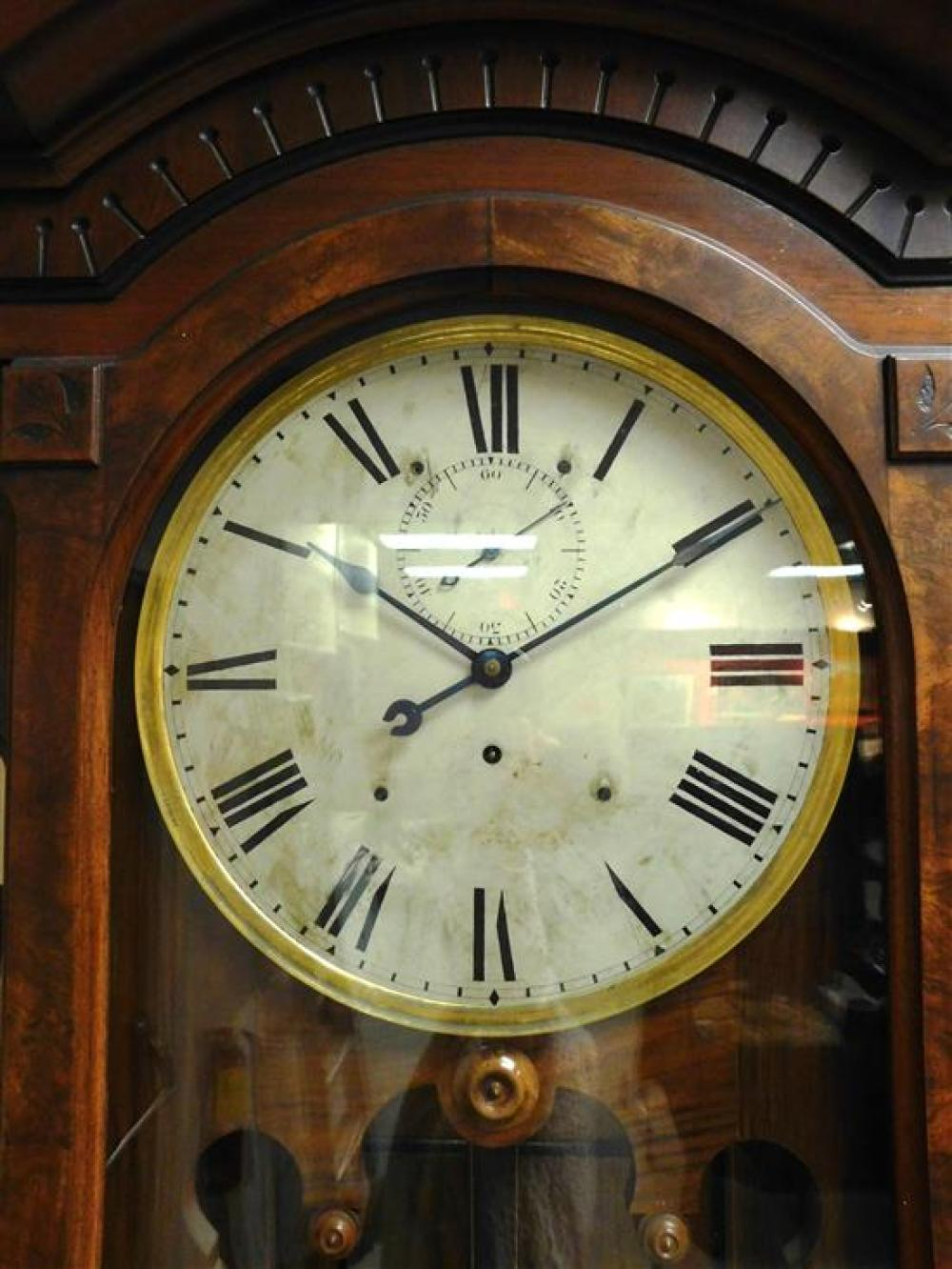 A circa 1886 Seth Thomas Regulator No. 14 or 15 case fitted with a No. 69 or 69A movement, the case having walnut and burled veneers...