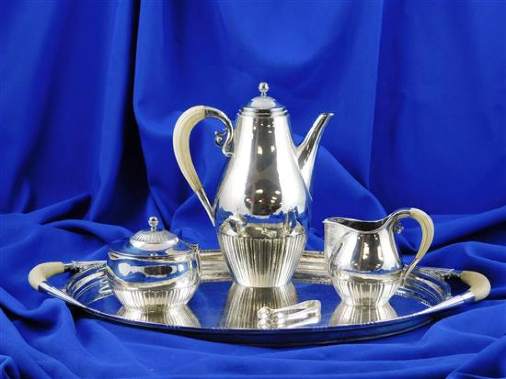 """STERLING: Georg Jensen sterling coffee set, """"Cosmos"""" pattern, details include: oblong tray with ivory handles, 20 1/4"""" l.; tall pot..."""
