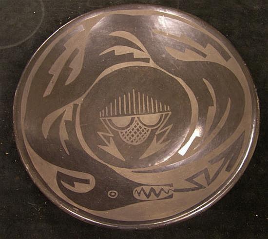 "Santa Clara Pueblo shallow blackware dish, signed ""Christina Naranjo/ Santa Clara [pue]"", 11 3/4"" diameter."