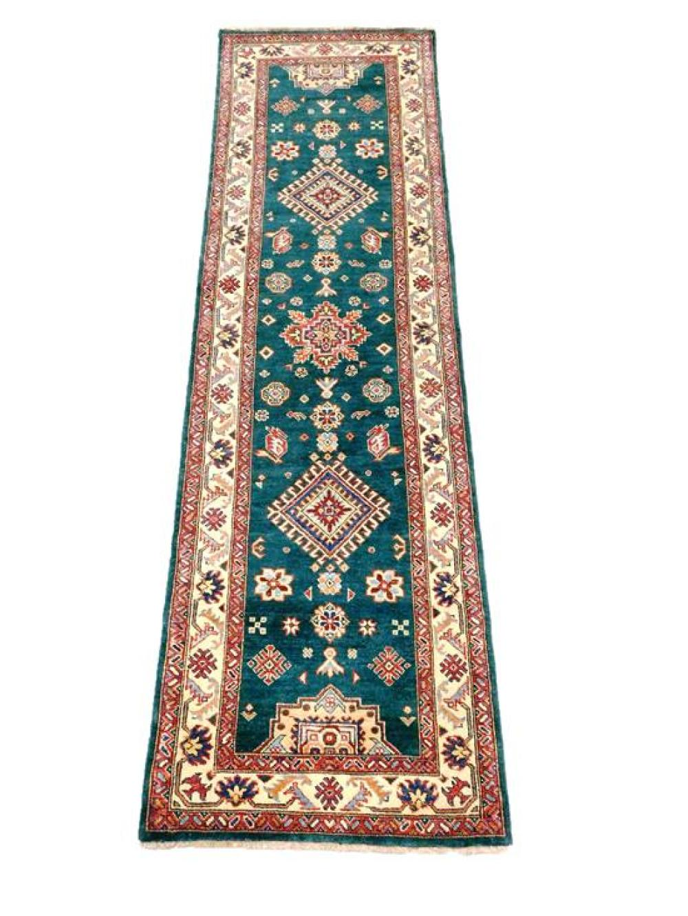 """RUG: Uzbek Kazak, 2' 8"""" x 9' 6"""", emerald field with angular and serrated medallions, ensconced in cream primary border with soft bri."""
