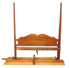Eldred Wheeler New England form reproduction tester bedstead, queen size, four flame finials, pencil posts with faceted sides suppor...