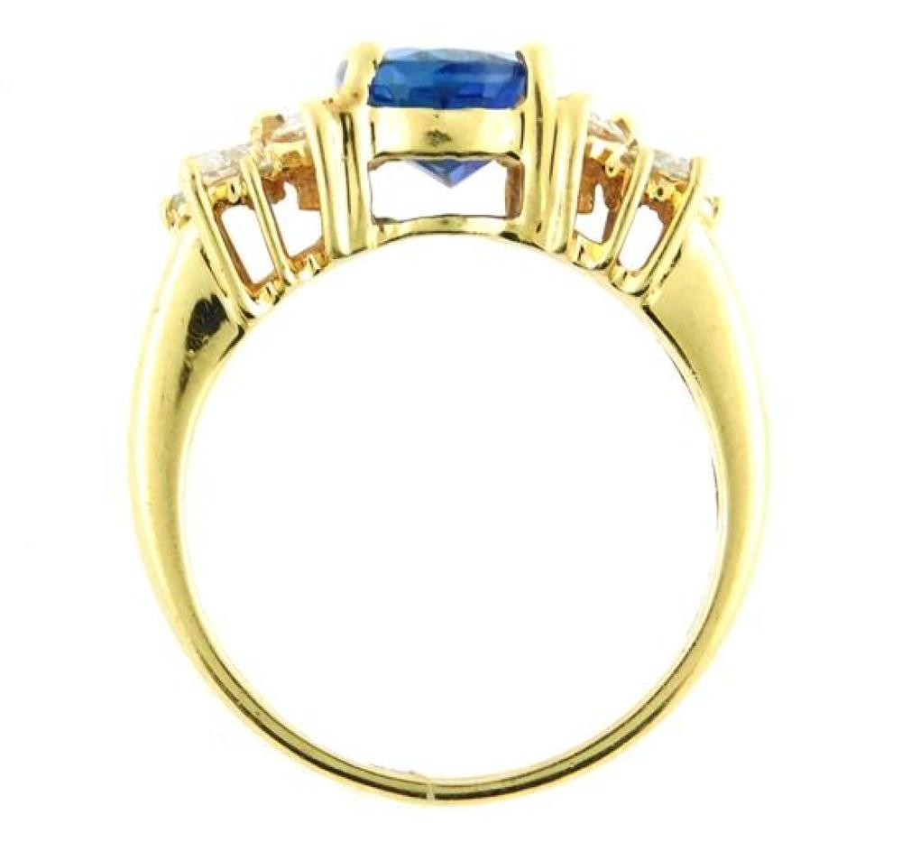JEWELRY: 14K Tanzanite and Diamond ring,14K yellow gold ring with (4) prong center setting, finger size: 7, center set with (1) oval...
