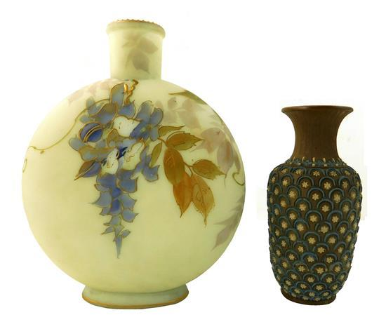 Two ceramic vases, 20th C., including: a Doulton Lambeth Arts and Crafts vase, brown with blue scallop and white flower motif, flare...