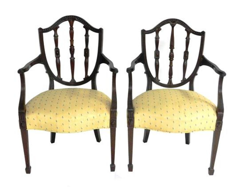 Georgian Hepplewhite style pair of shield back armchairs, ornately carved moldings and tri-column splat, reeded armrest supports and...