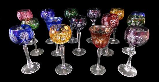 Fifteen pieces of cut to clear multicolor bowl stemware, includes groups of six, two and three with matching patterns, along with fo...