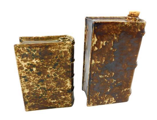 "POTTERY: American Bennington-type pottery, two book flasks including a flint enamel ""Bennington Battle Book Flask"" likely by Lyman, ..."