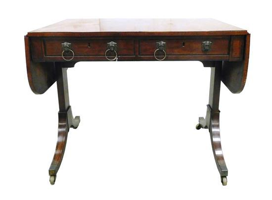 Sofa table, c. 1820, mahogany and mahogany veneer, two short drawers and two faux, all with dual stamped metal lions-head pulls, con...