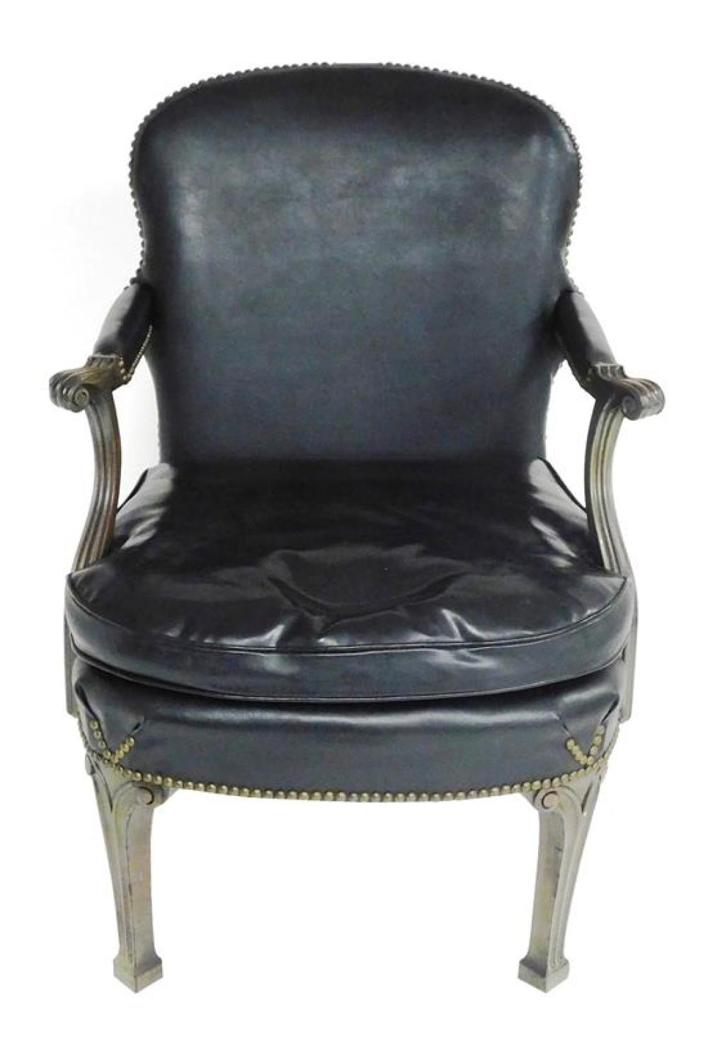 English style library chair, black Naugahyde upholstery to shaped back, removable seat cushion and skirt, brad border with name plaq...