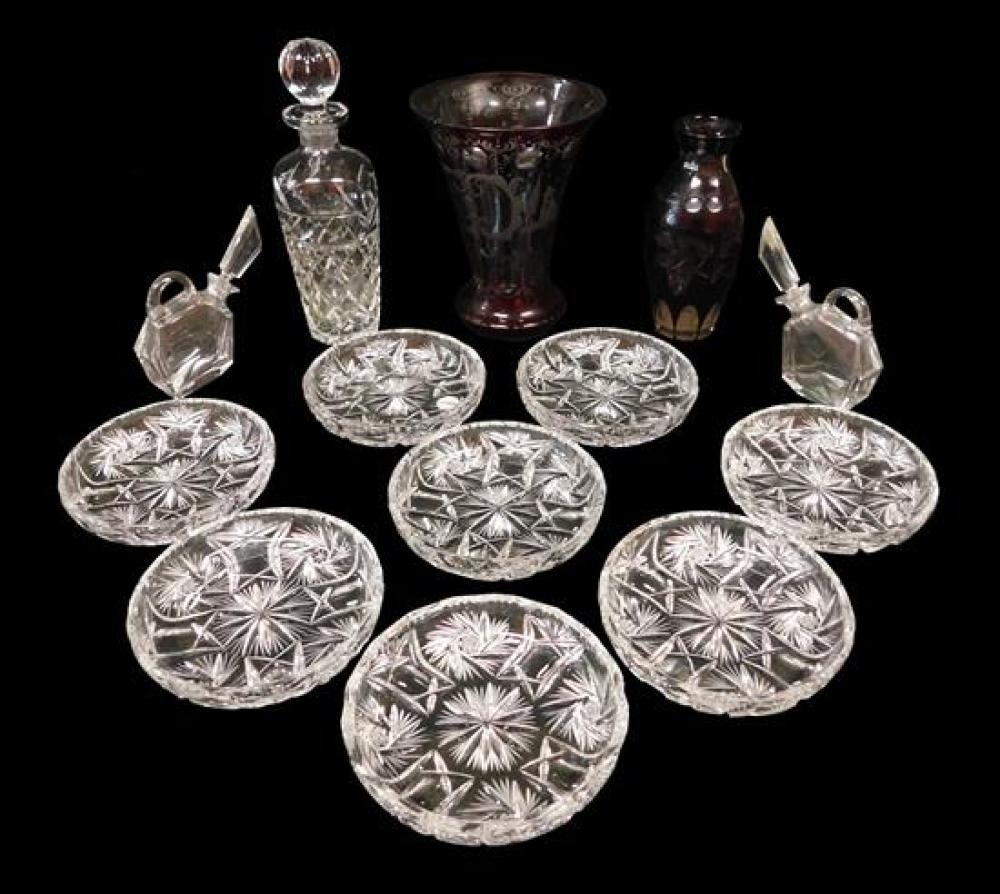 """Thirteen pieces of cut glass, including: two cranberry cut to clear vases, one with fluted top, 8"""" h., one with tapered neck; one cl..."""
