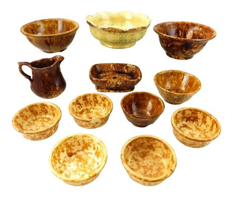 POTTERY: American Bennington-type stoneware, twelve pieces, 19th - 20th C., details include: assembled set of four mixing bowls, Roc...