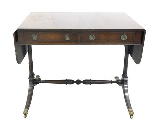 Georgian style sofa table, English, late 19th/ early 20th C., mahogany with oak secondary, two short drawers with stamped wreath-for...