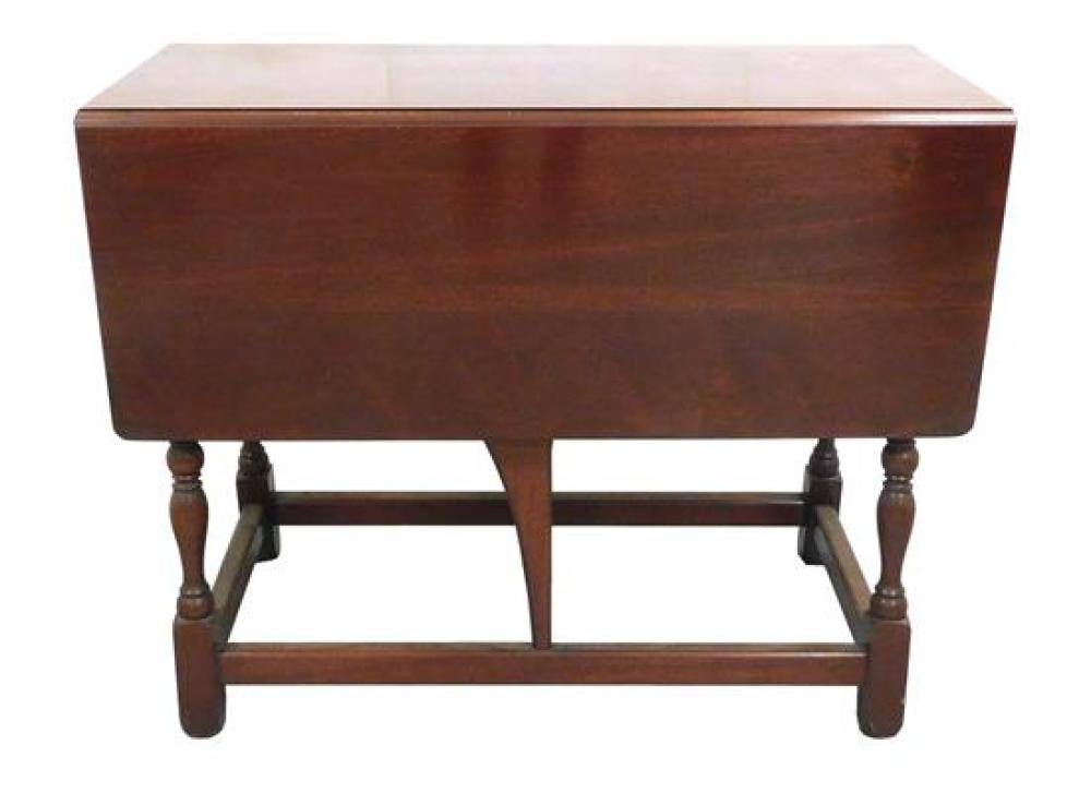 Dropleaf table, turned legs on square feet, small drawer at center on one side, wear consistent with age and use including light wea...
