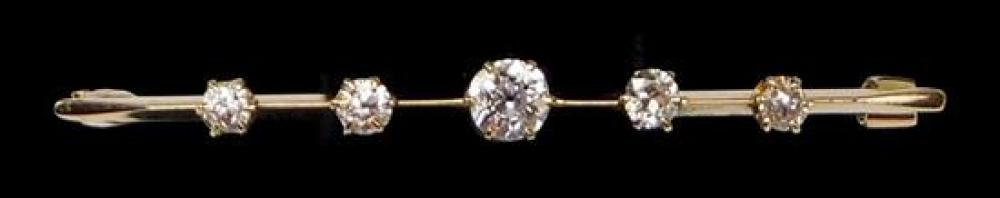 """JEWELRY: 14K Antique Diamond Bar Pin: 14K yellow gold antique bar pin with five six-prong crowns, 2"""" l., center set with one old Eur..."""