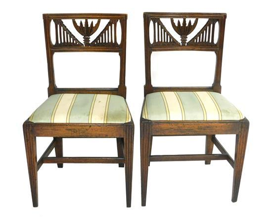 Pair of nicely carved side chairs, Continental, 18th C. with restorations, molded frame with horizontal splat featuring a pierced ac...