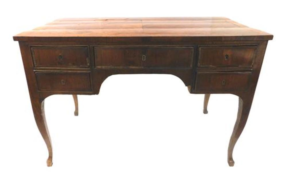 Continental desk, late 18th/ 19th C., butterfly veneer to top and front, heavy wear consistent with age and use including loss of ve...