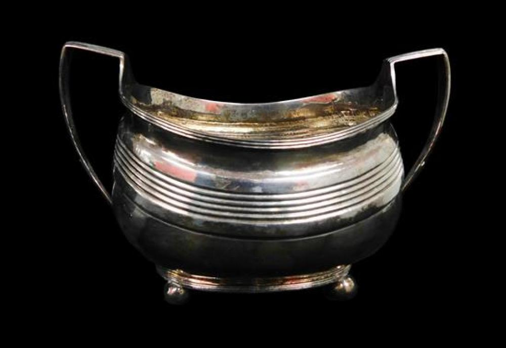 SILVER: English sterling tea service, Exeter, 1815, four pieces, includes: two pots, taller with ivory/bone insulators and wooden fi...